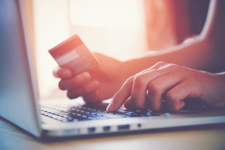 Hands holding credit card and using laptop. Online Shopping © Ivan Kruk